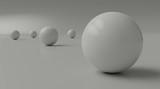 A few white balls on a light floor. 3D rendering