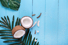 Coconut And Palm Branch On A B...