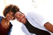 Beautiful fun couple laughing together on white background