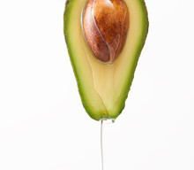 Dripping Oil On A Cut Avocado ...