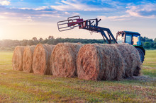Tractor Collects Bales Of Hay