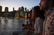 canvas print picture - Group Of Young Friends On Trip To Manhattan At Dusk