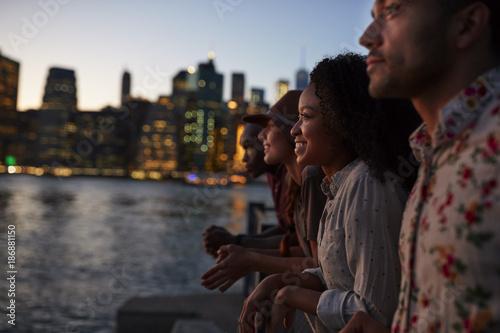fototapeta na lodówkę Group Of Young Friends On Trip To Manhattan At Dusk