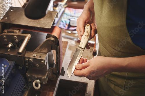 Making of a knife Fototapeta