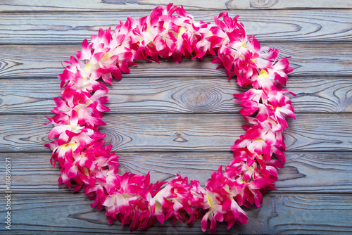 Hawaiian wreath on a wooden background.
