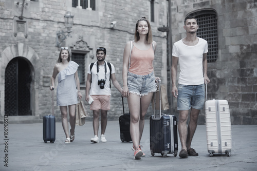 Active couple in shorts with luggage