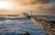 Coastal Storm, 01/01/2018 Cornwall, UK. Porthleven Harbour Fighting Stormy Weather As The Sun Breaks Through