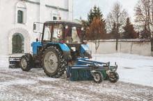 Blue Bulldozer Cleans The Stre...