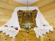 The Orthodox Icon Of The Mother Of God And Jesus With The Lamp In The Corner Of The Room.