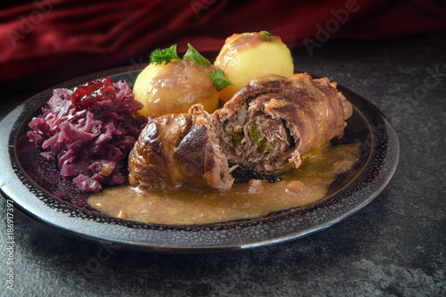 Fototapeta beef roulades, traditional german meal, filled meat rolls with red cabbage, pota