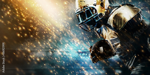Canvas Print American football sportsman player on stadium running in action