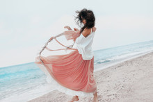 Beautiful Young Stylish Woman In Pink Skirt On The Beach