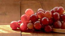 The Closeup Of Red Grapes On A...