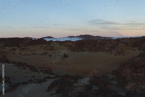 Spoed Foto op Canvas Grijze traf. Desert landscape with sunset light on mountains in background