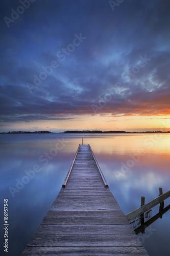 Fototapeta Jetty on a lake at sunrise, near Amsterdam The Netherlands obraz na płótnie