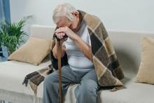 Tired Senior Man Wearing Plaid...