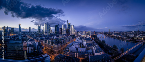 Germany, Frankfurt, River Main, skyline of finanial district in the evening