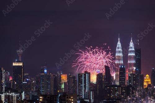 Canvas Prints Kuala Lumpur KUALA LUMPUR, MALAYSIA - 1ST JANUARY 2018; Fireworks explode near Malaysia's landmark Petronas Twin Towers during New Year celebrations in Kuala Lumpur.