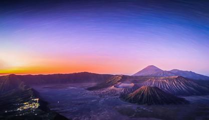 Mount Bromo volcano (Gunung Bromo) at sunrise with star trail in Bromo Tengger Semeru National Park, East Java, Indonesia.