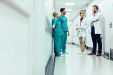 Team Of Doctors Having Discuss...