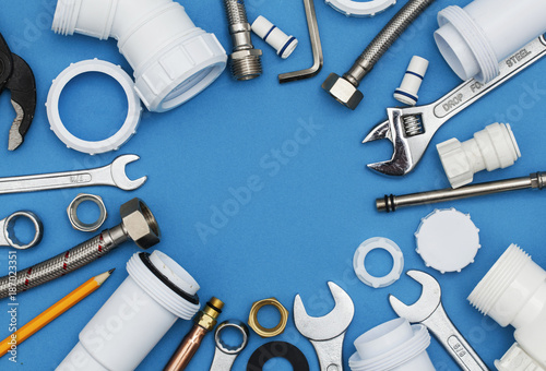 Fotografija Plumbing tools and equipment overhead view on a blue background