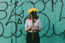 Woman Holding A Yellow Flower ...