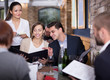 waitress female discusses order from guests