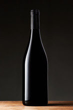 Black Wine Bottle Isolated On Black Background