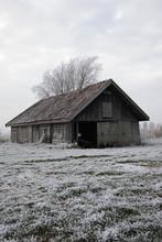 Rustic Old Barn In Frozen Fiel...