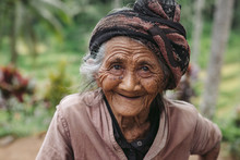 Portrait Of Old, Wrinkled Balinese Woman In Nature