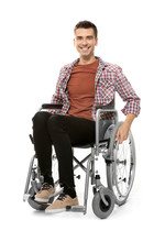 Young Man In Wheelchair On Whi...