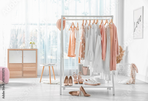 Collection of clothes hanging on rack in dressing room Fototapet