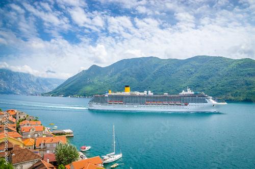 Photo Stands Ship beautiful mediterranean landscape. Mountains near town Perast, Kotor bay (Boka Kotorska), Montenegro.