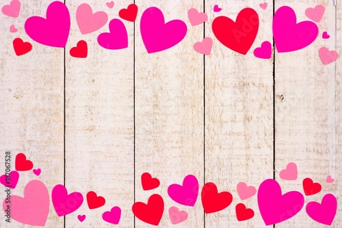 Valentines Day Double Border Of Red And Pink Paper Hearts Against A Rustic White Wood Background