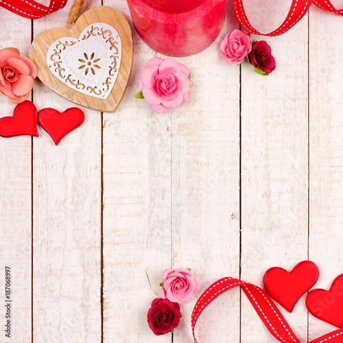 Valentines Day Corner Border Of Hearts Flowers Gifts And Decor Against A Rustic White