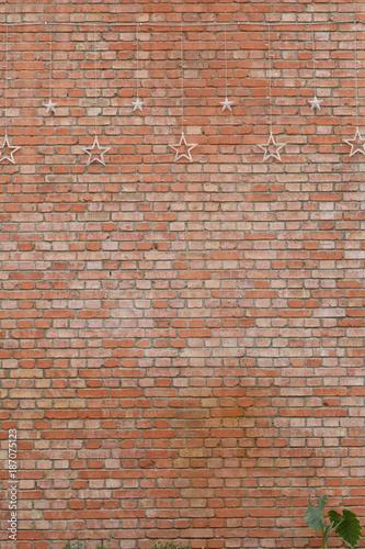 Spoed Fotobehang Baksteen muur A red brick wall and star's lamp ornament