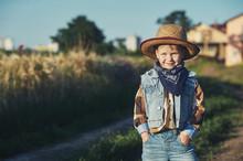 Portrait Of A Boy In A Straw Hat