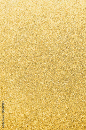 Gold glitter texture background of brilliant yellow metallic golden Christmas ho Wallpaper Mural