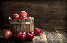 Red Ripe Apples In A Wooden Bu...