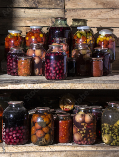 Canvas Prints Spices home preservation in a dark cellar in which breaks through several rays of light