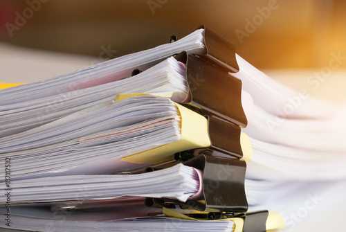 Fotografie, Obraz  Stack of Paper documents with clip, Pile of unfinished documents on office desk folders