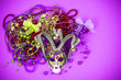 canvas print picture - Festival Mardi Gras mask and multicolored beads on bright background