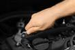 Auto mechanic repairing car, closeup