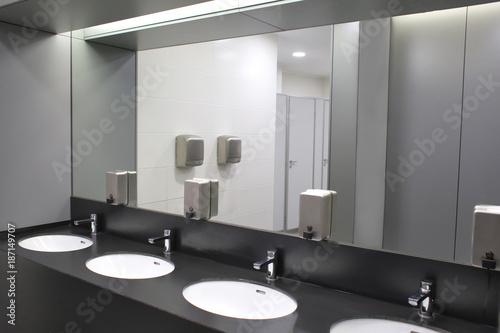 Fototapeta Modern sinks with mirror in public toilet obraz