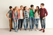 canvas print picture - Group of cute teenagers near white wall