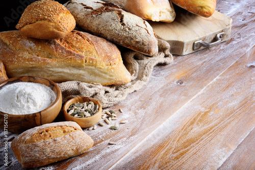 Fototapeta  Assorted bread on wood background