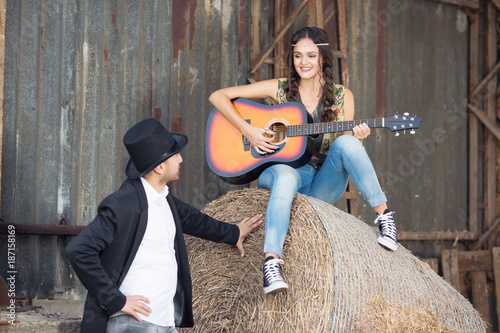 Beautiful woman in Pocahontas costume with guitar Poster