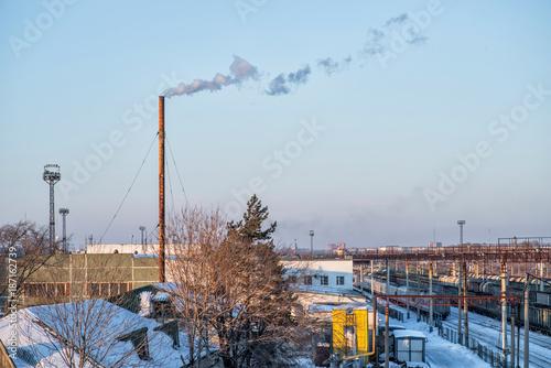 Foto op Plexiglas industrial area railway station with smoking chimney