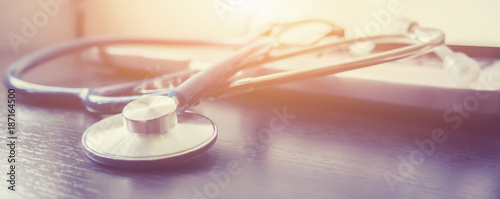 Fotografie, Obraz  Stethoscope and laptop keyboard on desktop in hospital,relax time doctor,medical concept,selective focus,vintage color