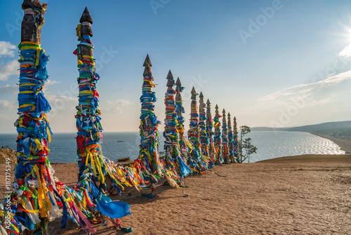 Sacred wooden columns with colourful ribbons, Baikal lake Wallpaper Mural